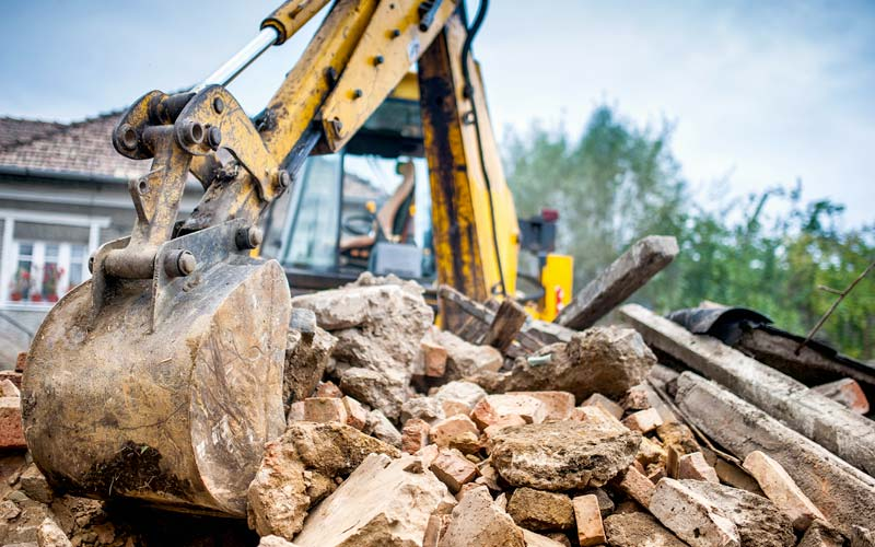JCB digger clearing a site in Leicestershire