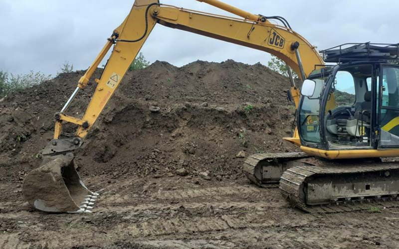 JCB digger digging foundations in Leicestershire